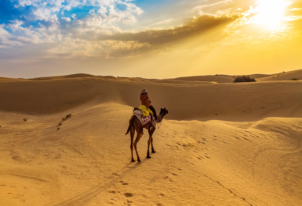 women-riding-camel-alone-at-desert of-merzouga-best tour-of-morocco